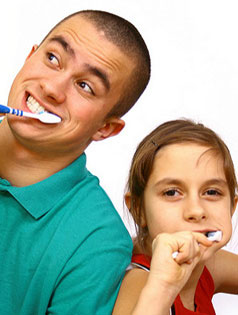 Photo of father and daughter brushing teeth